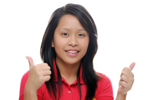 Asian girl looking happy with thumbs up
